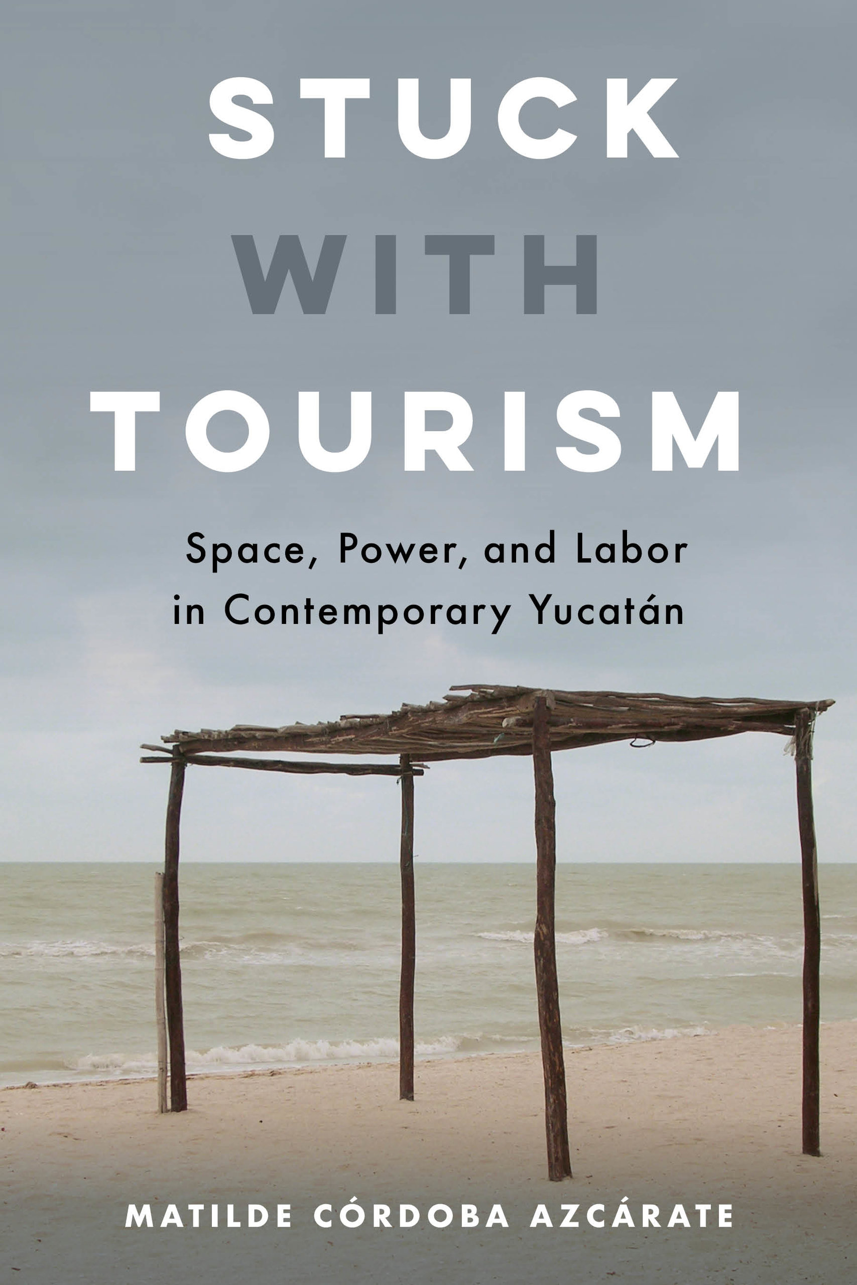 "book cover of Córdoba Azcárate's ""Stuck with Tourism"" showing a wooden structure in the desert"