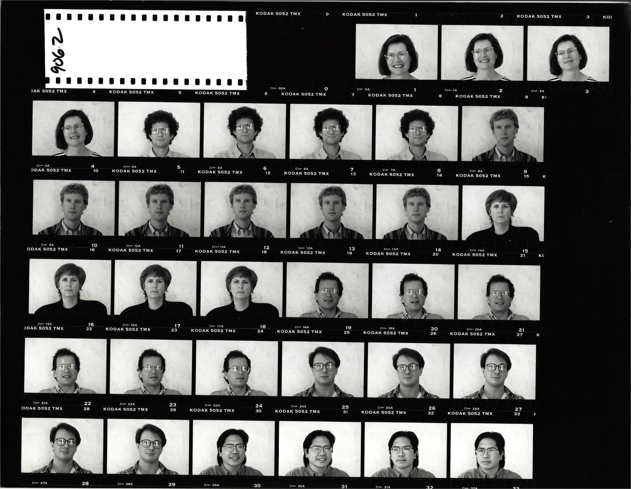 black and white scan of photo film negative rolls featuring headshots of faculty from the early 90s including Dr. Carol Padden and Dr. Daniel Hallin
